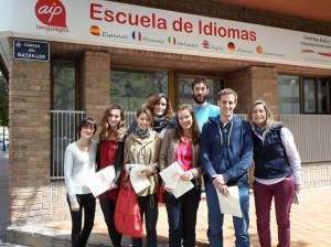 Some of our students who had the certification in front of the school with their teacher