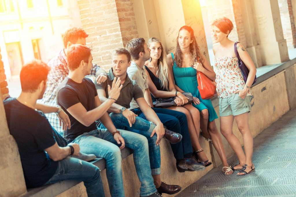 group of students and friends talking together to get to know better