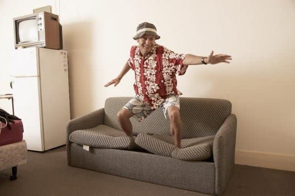 Men surfing on his sofa